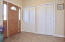spacious foyer with extra closet/storage space
