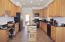 Huge kitchen with Stainless steel appliances and granite counter tops. Cool and easy to clean ceramic tile floors.