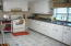 Big kitchen with corian counter tops and lots of cabinets!