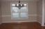 Chair rail, hardwoods, trey ceiling with crown molding