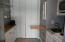 Kitchen with Bedroom doors pulled shut