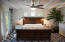 Plenty of natural lighting and cozy feel with the painted wood ceiling.