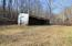 28' x 48' pole barn past garage offers additional storage or could be converted to stable or run-in shed with tack room. Spring right behind barn for natural water source.
