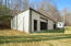40'x60' steel building with concrete floor, open span, skylights, and active electrical service with 220 power.