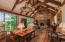 Living room: post & beam construction, custom stonework