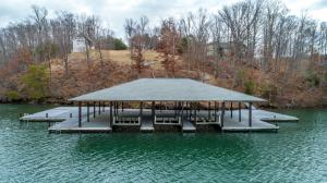 This beautiful point lot already has a well, septic, detached garage and Huge 3 bay boathouse