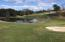 The spring view of #10 Fairway, green , sand trap and golf course pond