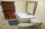 New vanity, new faucet, new light fixture, new exhaust fan & new mirror
