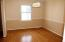 Bamboo hardwood flooring, chair rail, crown molding, fresh paint and new light fixture
