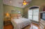 Oversize master suite with walk in closet, sitting room which could be den, office exercise space what ever best suite you. Tile walk in shower, custom vanity...very spa like.