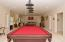 Billiard room with plenty of space for a card table and media room.