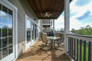 A beautiful deck overlooking the lake is perfect for relaxing.