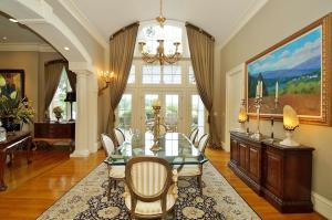 The formal dining room is easily asseabile by a wonderful butler's pantry and opulent tavern with wine cooler, bar and refrigerator.