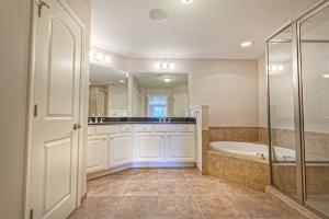 Walk in tile shower, jacuzzi tub and double sink