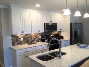 Stainless steel appliances, plenty of cabinet space, spacious counter space