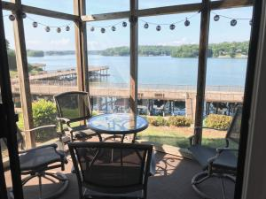 This screen porch has updated screen, new door and flooring and wonderful view of the lake