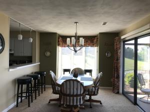 Dining area opens onto the screen porch and notice the windows on the side