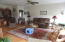 beautiful living room, has a gas fireplace, and large south facing windows