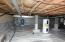 Encapsulated crawl space with new water heater and pressure tank