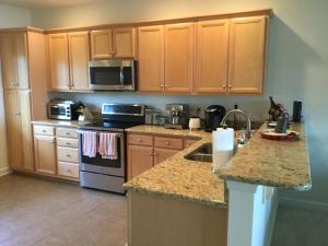 This kitchen has granite counter tops and an eat at counter