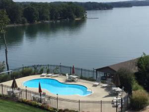 Pool is just steps away from the condo and overlooks the lake