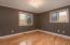 Bedroom 2 with laminate hardwood floor