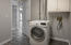 Laundry Room with dryer to convey