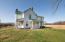 Farmhouse in good condition with standing seam metal roof, 3 covered porches & balcony