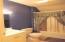 Second floor, located between 2nd bedroom and studio.