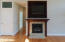 Gas Log Fireplace with Granite Surround. Large Cherry Cabinet Doors on Rollers. Internet & Sound System Command Center.