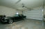 Oversized attached 2 car garage main level