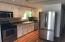 Spacious eat in kitchen with some new stainless appliances