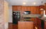 Kitchen with custom cabinets and granite