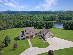 Beautiful home on 81 ac. farm with views of pond, pasture, or mountain from every window.