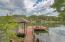 Single slip boat dock with stationary dock