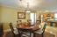 Dining room has chandelier and crown molding. An unseen window is to the left.