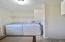Laundry/Mud Rm w/ hanging shelf, cabinets & access to furnace and water softener.