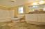 2nd Bath w/mirrored medicine cabinet, tub/shower & window.