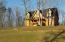 LOG Homes permitted! This home in in the subdivision