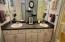 Lower-level full bath has double sinks ...