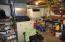 See the built-in storage under the stairs. Possessions will be emptied at sale.