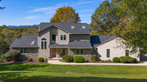 Rare find in Southern Botetourt with fantastically maintained contemporary on almost 10 acres in Woodland Farms