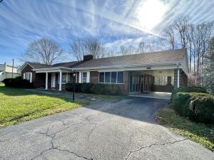 Brick Ranch with Single Carport on main level and Single Garage on Lower Level