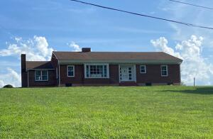 All brick ranch with partial walk up basement