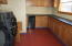 Mud room with washer Dryer, sink and wine cooler