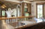 Open Kitchen to great room and terrace with pond