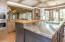 Open kitchen with casual dining area looking toward pond