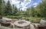 Firepit with privacy and views overlooking pond