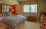 Large guest bedroom with creek view window