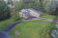 Almost a half acre of yard & trees for privacy surrounds the house